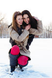 Two best friends hugging in the snow Stock Photography