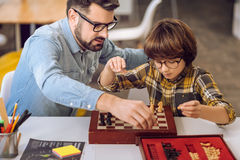 Two best friends laying chess on the desk Stock Photos