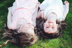 Two Best Friends Laying Together On Lawn Royalty Free Stock Photo