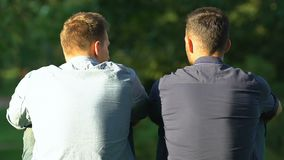 Free Two Best Friends Sitting Outdoor Discussing Life Problems, Friendship, Back-view Stock Images - 159218924