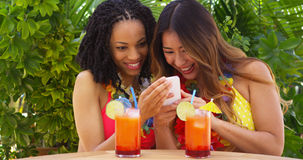 Two best friends taking selfie while on tropical vacation Royalty Free Stock Photography