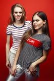 two best friends teenage girls together having fun, posing emoti royalty free stock photos