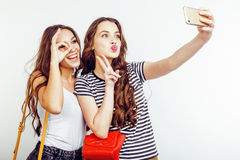 Two best friends teenage girls together having fun, posing emotional on white background, besties happy smiling Stock Images