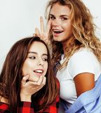 Two best friends teenage girls together having fun, posing emotional on white background, besties happy smiling, making stock images