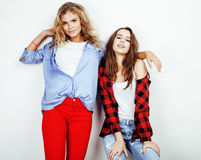 Two best friends teenage girls together having fun, posing emotional on white background, besties happy smiling, making Stock Photography