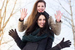 Two best friends waving Royalty Free Stock Photography