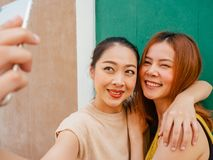 Two best friends women are taking selfie of thier trip. Two Asian best friends women are taking selfie of thier trip stock photography