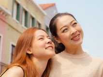 Two best friends women tourists travel in European town. Two Asian best friends women tourists travel in European town stock photos