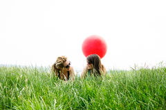 Two best girl friends laying on the grass Royalty Free Stock Photo