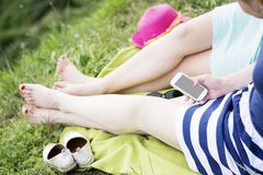 Two best girl friends laying on the grass Royalty Free Stock Images