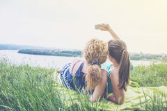 Two best girl friends taking selfie Stock Photo