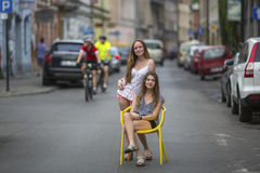 Two best girlfriends in the old European town, conceptual photo about the vacation. Stock Photo