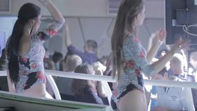 Two best go-go dance girls performing for big party. Stock footage stock video footage