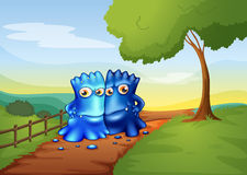 Two bestfriend monsters going to the farm Royalty Free Stock Photography