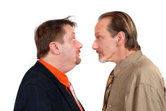 Two bewildered men facing. Two mature men facing each other with an amazed and bewildered look, isolated over white Stock Photography