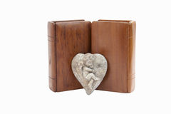 Two Bibles With Wooden Covers And Pewter Cherub Royalty Free Stock Images