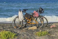Two bicycle at the beach. On blue sky Royalty Free Stock Images