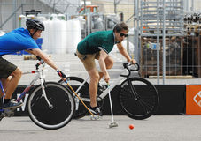 Two bicycle polo players Royalty Free Stock Image