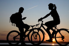 Two bicycler on sunset. Two bicycler accidentally meet  on sunset Stock Images