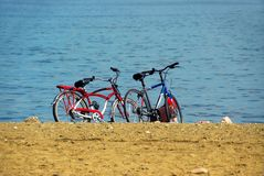 Two bicycles on beach royalty free stock photos