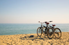 Two bicycles on the beach. Barcelona, Spain. Coulple on the breach. Sunny weather, goodmood Royalty Free Stock Photos