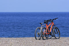 Two bicycles on beach Stock Image