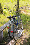 Two bicycles. Two bike stand near the benches clear day Royalty Free Stock Photo