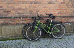 Two bicycles. At bricks wall Stock Photography