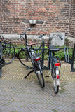 Two bicycles in the city center of Venlo on a brick wall Royalty Free Stock Image