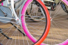 Two bicycles with colorful wheels parked. s Stock Image
