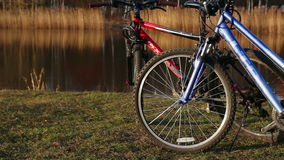 Two bicycles dolly shot. Two bicycles. Beautiful river in early spring. Calm wearher. Dolly shot Full HD stock footage