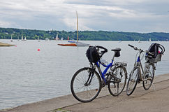 Two bicycles by a lake. Bicycles by a lake. Starnbergersee, Germany Stock Photo