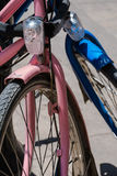 Two bicycles in love. A pink and a blue bicycle chained together to a pole Royalty Free Stock Images