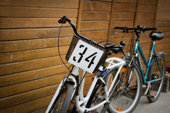 Two bicycles. Near the wall Royalty Free Stock Image