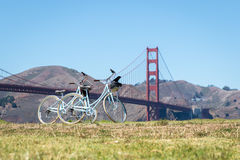 Two bicycles parked on grass in front of Golden Gate Bridge Stock Photography