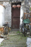 Two bicycles parked outside a slum royalty free stock image