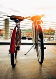 Two bicycles side by side in city Stock Images