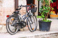 Two bicycles stand near an Italian restaurant Stock Photos