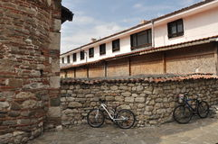 Two bicycles at a stone wall Royalty Free Stock Images