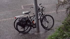 Two bicycles in the summer rain stock video footage