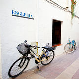 Two bicycles at a white wall Stock Photos