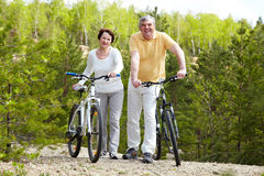 Two bicyclists Stock Images