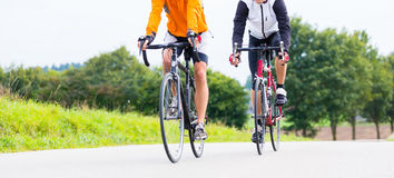 Two bicyclists doing sport with their bikes Royalty Free Stock Photo