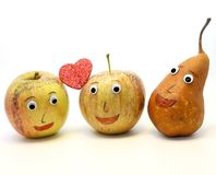 Two big apples with the heart and a PEAR Royalty Free Stock Photos