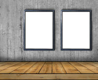 Two big blank billboard attached to a concrete wall inside with wooden floor Stock Images