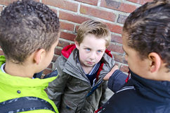 Kids bullying small boy Stock Photos