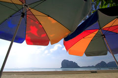 Two big colorful umbrellas at the beach Royalty Free Stock Images