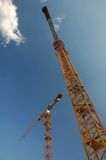 Two Big Cranes Royalty Free Stock Images