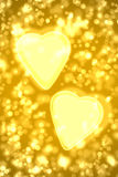 Two big gold hearts Stock Photos