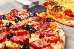 Two big hot and tasty pizzas Royalty Free Stock Photography